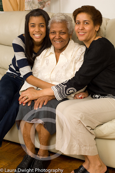 three female generations of one family maternal grandmother, mother in 40s, and daughter age 20 Dominican-American