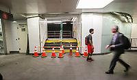 The closed off entrance to the old South Ferry station in the newly restored South Ferry subway station in New York on re-opening day Tuesday, June 27, 2017. The restored station was closed after catastrophic damage by Superstorm Sandy with an estimated 15 million gallons of water flooding the terminal which cost $545 million and was only open three years. The $340 million in repairs were finished today nearly five years after Superstorm Sandy. In the interim the Number One train used the quirky old South Ferry loop which only accommodated the first five cars of a ten car train.  (© Richard B. Levine)