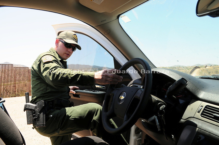 Tucson, Arizona - U.S. Customs Border Protection (CBP) Public Affairs officer Jeremy Copeland boards his vehicle near the U.S.-Mexico border fence. He transported reporters to the  during a two-day event organized by the Tucson Sector Border Patrol. The event brought national and international journalists to the Arizona border to become acquainted with the dynamics of this area. Photo by Eduardo Barraza © 2012