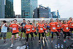 Runners in action during the Bloomberg Square Mile Relay at the The Promontory at Marina Bay on 27 October 2016 in Singapore. Photo by Weixiang Lim / Power Sport Images
