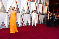 Greta Gerwig, left, and Timothee Chalamet arrive at the Oscars on Sunday, March 4, 2018, at the Dolby Theatre in Los Angeles. (Photo by Jordan Strauss/Invision/AP)