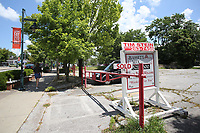 NWA Democrat-Gazette/DAVID GOTTSCHALK   One of the five parcels of land at 151 W. Dickson St. sold for $4.4 million in late June to an investor in Colorado who graduated from the University of Arkansas. This is the site of the former Divinity Hotel project by Brandon Barber. It's been an empty parking lot with some trees and Lamar Pettus' old law building for years.