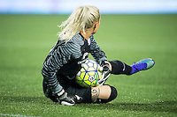 Orlando, Florida - Saturday, April 23, 2016: Orlando Pride goalkeeper Ashlyn Harris (1) slides to make a save during an NWSL match between Orlando Pride and Houston Dash at the Orlando Citrus Bowl.