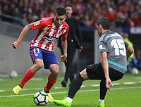 Atletico Madrid's Argentinian forward Angel Correa; Malaga's defender Federico Ricca