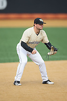 Wake Forest Demon Deacons third baseman Nate Mondou (10) on defense against the Harvard Crimson at David F. Couch Ballpark on March 5, 2016 in Winston-Salem, North Carolina.  The Crimson defeated the Demon Deacons 6-3.  (Brian Westerholt/Four Seam Images)