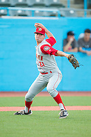 Brooklyn Cyclones relief pitcher Brandon Welch (21) makes a throw to first base against the Hudson Valley Renegades at Dutchess Stadium on June 18, 2014 in Wappingers Falls, New York.  The Cyclones defeated the Renegades 4-3 in 10 innings.  (Brian Westerholt/Four Seam Images)