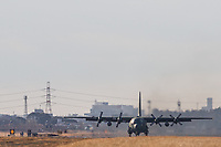 A Lockheed C130 Hercules transport aircraft with the Japanese Self Defence Force (JSDF) lands at  Air Facility, Atsugi, Yamato, Kanagawa, Japan. Wednesday January 16th 2019