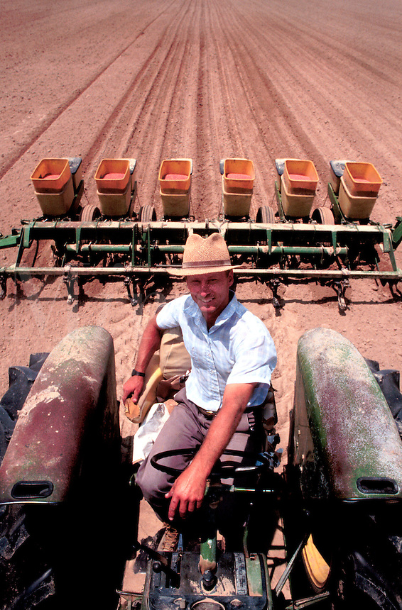 Farmer on tractor planting soy beans