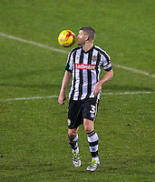 Carl Dickinson of Notts Co during the Sky Bet League 2 match between Notts County and Wycombe Wanderers at Meadow Lane, Nottingham, England on 10 December 2016. Photo by Andy Rowland.