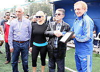 Minos Kyriakou (3rd L) with his with his wife Mari Konstandatou with his with his wife Mari Konstandatou Mari Konstandatou (2nd L) during a friendly football game between two tv networks to fundraise for UNESCO