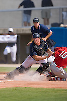 Catcher Ray Redden (4) of the Danville Braves puts the tag on Curt Smith (10) of the Johnson City Cardinals at Dan Daniels Park in Danville, VA, Sunday July 27, 2008.