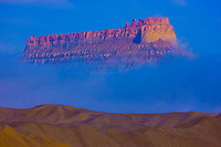 Factory Butte and fog, Proposed wilderness, Utah, Giant Butte rising above fog and badlands,<br /> Morning<br /> 67 H C