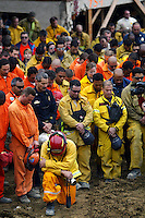 "LA CONCHITA, CA - JANUARY 13:  Hundreds of rescue workers gathered to observe a moment of silence January 13, 2005 at a memorial service for the victims of the massive mudslide in La Conchita, California. The service was held after announcement that the rescue phase of the relief operation was ending and workers will now try to find a way for evacuated residents to return to what authorities say remains a ""geologically hazardous"" area.  (Photo by Spencer Weiner-Pool/Getty Images)"