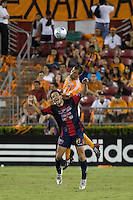 Atlante FC forwarad Luis Gabriel Rey (11) and Houston Dynamo defender Patrick Ianni (4) go up for the header. Houston Dynamo defeated Atlante FC 4-0 during the group stage of the Superliga 2008 tournament at Robertson Stadium in Houston, TX on July 12, 2008.