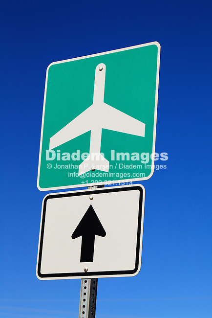 Airport sign with directional arrow.