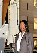Jeannette Epps, a member of the Astronaut Class of 2009, poses for a photo near a model of the Space Shuttle Columbia at the National Air and Space Museum in Washington, D.C. on Friday, July 17, 2009.<br /> Credit: Ron Sachs / CNP