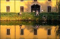 Rozzano (Milano). Pescatori specchiati nelle acque del Naviglio Pavese  --- Rozzano (Milan). Fishermen mirrored in the water of the canal Naviglio Pavese