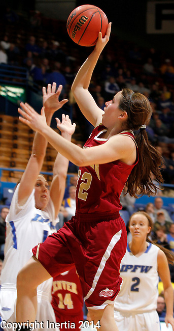 SIOUX FALLS, SD - MARCH 9:  Paige Bradley #22 from Denver  takes the ball to the basket against Amanda Hyde #11 from IPFW in the second half of their game Sunday afternoon at the 2014 Summit League Basketball Tournament in Sioux Falls, SD. (Photo by Dave Eggen/Inertia)