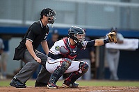 Danville Braves catcher Brett Cumberland (26) frames a pitch as home plate umpire Mark Bass looks on during the game against the Pulaski Yankees at American Legion Post 325 Field on August 1, 2016 in Danville, Virginia.  The Yankees defeated the Braves 4-1.  (Brian Westerholt/Four Seam Images)