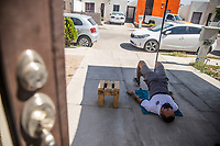 HERMOSILLO, MEXICO - MAY 08: Oscar Rai Villa de los Cimarrones De Sonora performs training in the garage of his house located in the Altares neighborhood south of the city, here the streets look desolate, his neighbors remain inside their homes amid the Coronavirus pandemic and a heat 40 degrees Celsius <br />  on May 8, 2020 in Hermosillo, Mexico. Due to the Coronavirus crisis the Liga MX has announced the cancellation of the Ascenso MX 2019-2020 season and to temporarily suspend promotions and relegations for the next six seasons. (Photo by Luis Gutierrez/Norte Photo/Getty Images)