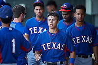 AZL Rangers Cody Freeman (33) is congratulated by Randy Florentino (1) after scoring a run during an Arizona League game against the AZL Athletics Gold on July 15, 2019 at Hohokam Stadium in Mesa, Arizona. The AZL Athletics Gold defeated the AZL Rangers 9-8 in 11 innings. (Zachary Lucy/Four Seam Images)
