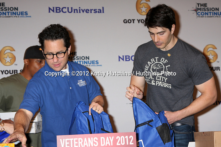 "LOS ANGELES - NOV 9:  JJ Abrams, Brandon Routh at the Veterans Day Service Event to feed LA Children sponsored by ""The Mission Continues"" and ""Got Your 6"" organizations. at Globe Theater at Universal Studios on November 9, 2012 in Los Angeles, CA"