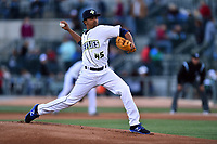 Pitcher Harol Gonzalez (45) of the Columbia Fireflies delivers a pitch in a game against the Augusta GreenJackets on Opening Day, Thursday, April 6, 2017, at Spirit Communications Park in Columbia, South Carolina. Columbia won, 14-7. (Tom Priddy/Four Seam Images)