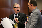 Nevada Sen. David Parks, D-Las Vegas, left, talks with staffer Michael Stewart on the Senate floor at the Legislative Building in Carson City, Nev., on Monday, April 22, 2013. .Photo by Cathleen Allison