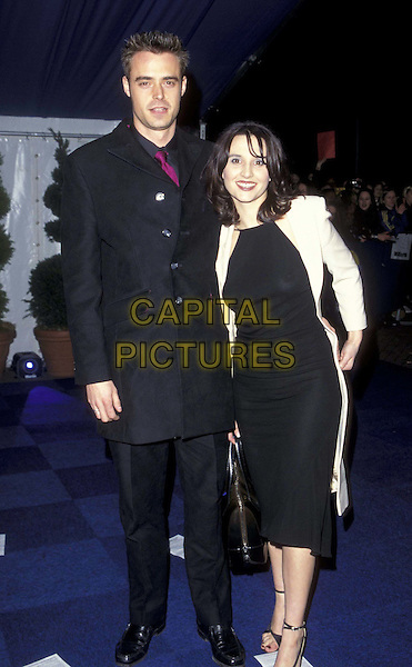 JAMIE THEAKSTON & JAYNE MIDDLEMASS.09 February 1998.ref:7063.full length, full-length, black suit.www.capitalpictures.com.sales@capitalpictures.com.©Capital Pictures