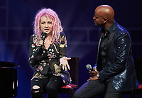 """Die US-amerikanische Sängerin Cyndi Lauper und der Moderator Yared Dibaba unterhalten sich am The singer Cyndi Lauper (L) and the moderator Yared Dibaba speak on stage of the Operettenhaus during a press showing of the musical """"Kinky Boots"""" in Hamburg, Germany, 28. September 2017. The Germany premiere will be on the 3rd of December. Photo: Georg Wendt/dpa /MediaPunch ***FOR USA ONLY***"""