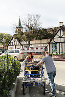 A couple rides a surrey by Rasmussen's, Solvang, California. Images are available for editorial licensing, either directly or through Gallery Stock. Some images are available for commercial licensing. Please contact lisa@lisacorsonphotography.com for more information.