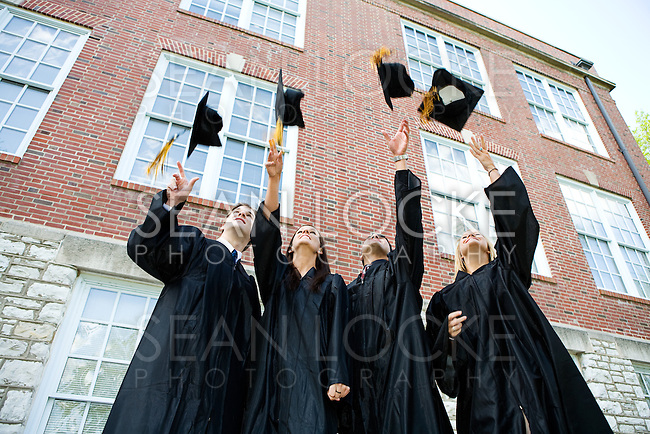 Extensive series of recent student graduates after graduation, outside with friends.  Muti-ethnic group includes parents as well.