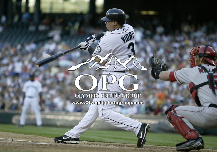 01 August 2007:   Seattle Mariners designated hitter Jose Vidro takes a swing at a pitch against the Los Angeles Angels at Safeco Field. Seattle won 8-7 in 12 innings.