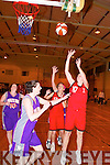 And again. St Mary's Mags O'Donoghue shoots over St Paul's Mary Carmody Tarrant's outstretched arms to net another basket.    Copyright Kerry's Eye 2008