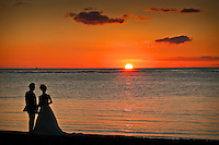 Sunset wedding at Ala Moana Beach Park near Waikiki, Honolulu, O'ahu.