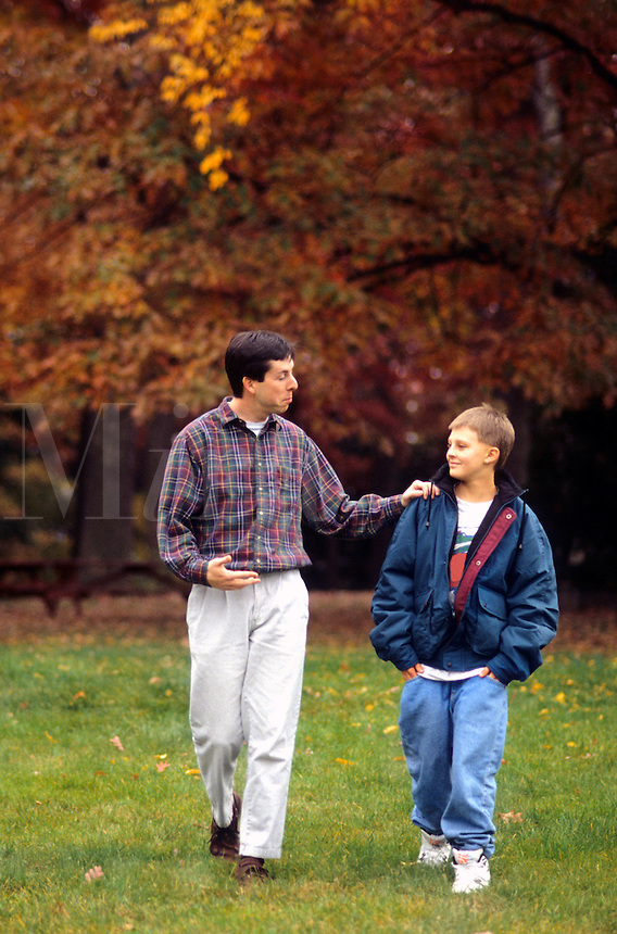 Man and teenager talking and advice on drug counseling or problems in par