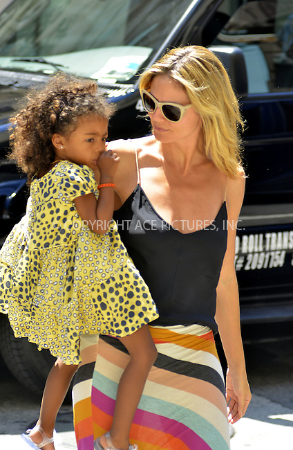 WWW.ACEPIXS.COM . . . . .  ....JUly 10 2012, New york City....Heidi Klum carries her daughter Lou Sulola Samuel from a downtown hotel on July 10 2012 in New York City....Please byline: CURTIS MEANS - ACE PICTURES.... *** ***..Ace Pictures, Inc:  ..Philip Vaughan (212) 243-8787 or (646) 769 0430..e-mail: info@acepixs.com..web: http://www.acepixs.com