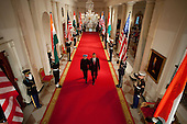 Washington, DC - November 24, 2009 -- United States President Barack Obama and Prime Minister Manmohan Singh of India walk down the Cross Hall as the official State Arrival ceremony begins in the East Room of the White House, November 24, 2009. .Mandatory Credit: Chuck Kennedy - White House via CNP