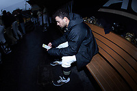 Patrick Frick of the Wake Forest Demon Deacons goes over notes prior to the game against the Notre Dame Fighting Irish at David F. Couch Ballpark on March 10, 2019 in  Winston-Salem, North Carolina. The Demon Deacons defeated the Fighting Irish 7-4 in game one of a double-header.  (Brian Westerholt/Four Seam Images)