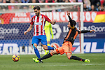 Yannick Ferreira Carrasco of Atletico de Madrid competes for the ball with Enzo Nicolas Perez of Valencia CF (right) during the match Atletico de Madrid vs Valencia CF, a La Liga match at the Estadio Vicente Calderon on 05 March 2017 in Madrid, Spain. Photo by Diego Gonzalez Souto / Power Sport Images