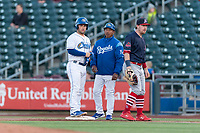 Omaha Storm Chasers Nick Dini (8) stands at first base with Kansas City Royals roving coach Rafael Belliard and first baseman John Nogowski (40) during a Pacific Coast League game against the Memphis Redbirds on April 26, 2019 at Werner Park in Omaha, Nebraska. Memphis defeated Omaha 7-3. (Zachary Lucy/Four Seam Images)