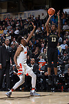 Bryant Crawford (13) of the Wake Forest Demon Deacons shoots over Oshae Brissett (11) of the Syracuse Orange during second half action at the LJVM Coliseum on January 3, 2018 in Winston-Salem, North Carolina.  The Demon Deacons defeated the Orange 73-67.  (Brian Westerholt/Sports On Film)