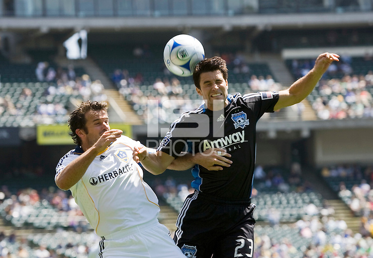 June 20, 2009:  Michael Zaher of Earthquakes and Chris Klein of Galaxy jumps for the ball during a game against LA Galaxy at Coliseum in Oakland, California. San Jose Earthquakes defeated Los Angeles, 2-1