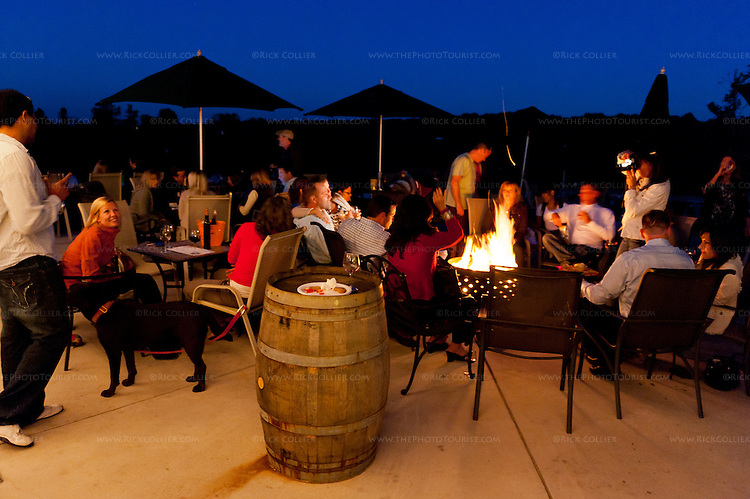 Happy visitors enjoy their wine and the firepits distributed around the patio at Barrel Oak Winery (just after sunset during the annual harvest party).