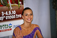 "Joanna Mitrosz of Poland smiles to camera at ""kiss & cry"" during event finals at 2010 Holon Grand Prix at Holon, Israel on September 4, 2010.  (Photo by Tom Theobald)."
