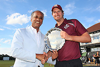 Dilip Jajodia of Dukes presents the trophy to Jon Walford of Brentwood - Essex Cricket League Dukes T20 Finals Day at Billericay Cricket Club - 28/07/13 - MANDATORY CREDIT: Gavin Ellis/TGSPHOTO - Self billing applies where appropriate - 0845 094 6026 - contact@tgsphoto.co.uk - NO UNPAID USE