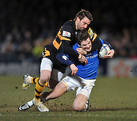 Gordon D'Arcy is tackled around the neck by Nicky Robinson. Amlin Challenge Cup quarter-final, between London Wasps and Leinster on April 5, 2013 at Adams Park in High Wycombe, England. Photo by: Patrick Khachfe / Onside Images