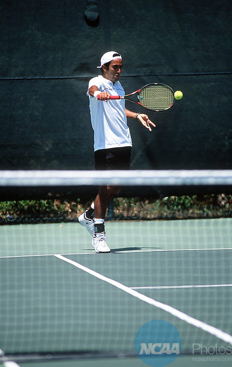 """14 MAY 2000:   Fernando Las Heras of Lander University nails a backhand at the Division 2 Men's Tennis Championships held at the Ralph """"""""Skeeter"""""""" Carson Tennis Complex on the University of Florida campus in Pensacola, FL.  Lander defeated Hawaii Pacific 5-2 for the championship title.  Gene Sowell/NCAA Photos"""