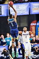 MAR 7, 2016: Baltimore, MD - Tournament MVP North Carolina-Wilmington Seahawks guard Chris Flemmings (1) hits a three pointer over Hofstra Pride guard Juan'ya Green (1) during the Championship game of the CAA Basketball Tournament at Royal Farms Arena in Baltimore, Maryland. (Photo by Philip Peters/Media Images International)