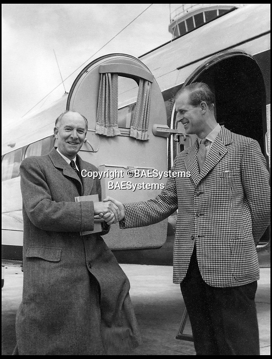 BNPS.co.uk (01202 558833)<br /> Pic: BAESystems<br /> <br /> Sir Geoffrey de Havilland delivers a Heron C3 to Prince Philip in 1955.<br /> <br /> A new book gives an intimate look behind the scenes of the Royal Flight and also the flying Royals.<br /> <br /> Starting in 1917 the book charts in pictures the 100 year evolution of first the King's Flight and then later the Queen's Flight as well as the Royal families passion for aviation.<br /> <br /> Author Keith Wilson has had unprecedented access to the Queen's Flight Archives to provide a fascinating insight into both Royal and aeronautical history.